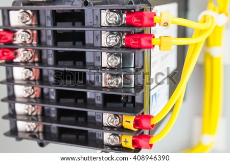 Electrical control panel line with static energy meters and safety circuit - stock photo