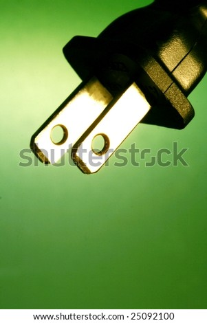 electrical cord against green background - stock photo