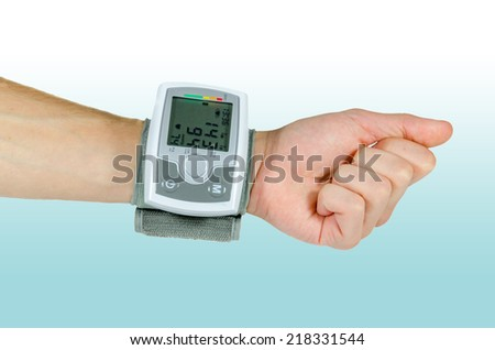 Electrical device for measuring blood pressure and heart rate used at hand wrist - stock photo