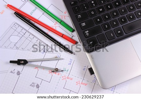 Electrical diagrams, accessories for drawing and laptop, drawings and accessories for the projects engineer jobs
