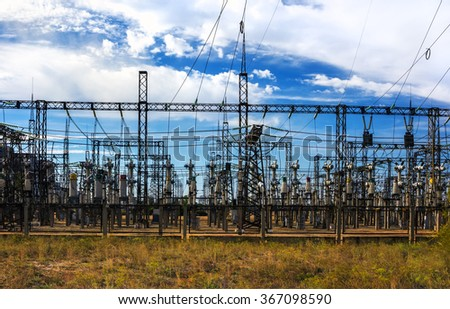 Electrical distribution station, transformers, high-voltage lines, electricity - stock photo