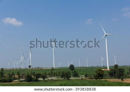 Electrical Eco power maker wind turbine in cassava farm - Huay bong, Nakhon Ratchasima, Thailand - stock photo