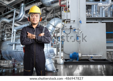 Electrical engineer working at control room of modern thermal power plant industrial