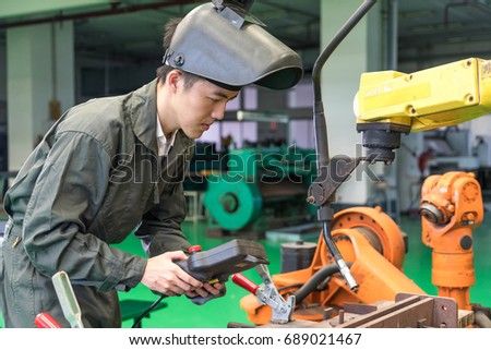 Electrical engineer working with a robot machine