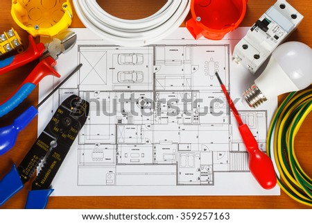 Electrical equipment, tools and house plans on the desk