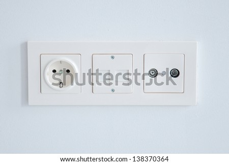 electrical, ethernet and tv or radio socket on the wall. - stock photo