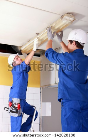 Electrical fitters - stock photo