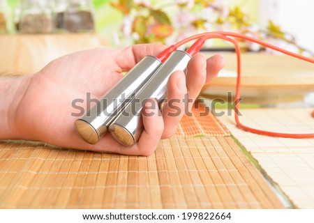 Electrical frequency therapy eleectrodes in hands. Biofeedback device used in alternative medicine electrotherapy. - stock photo