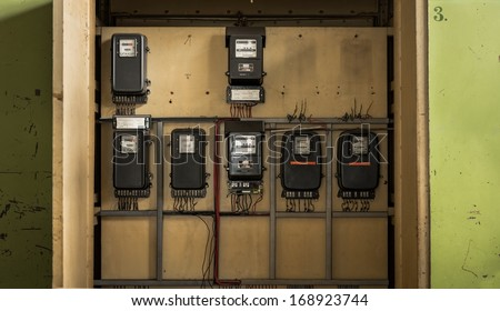 Electrical fuseboxes and power lines - stock photo