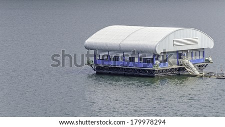 electrical generating station on a slow running river, Specialized equipment for electrical generating - stock photo
