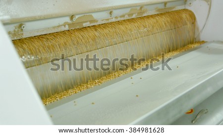 Electrical mill machinery for the production of wheat flour. Grain equipment. - stock photo