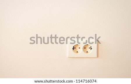 electrical outlet on the wall - stock photo