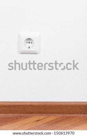 Electrical outlet on white wall, interior  - stock photo