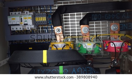 Electrical panel with circuit breakers and tyres - stock photo