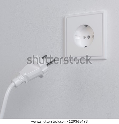 Electrical Plug and Socket. Metaphor of Electricity Consumption. (1st version) - stock photo