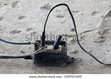 Electrical plugs in the outlet. - stock photo