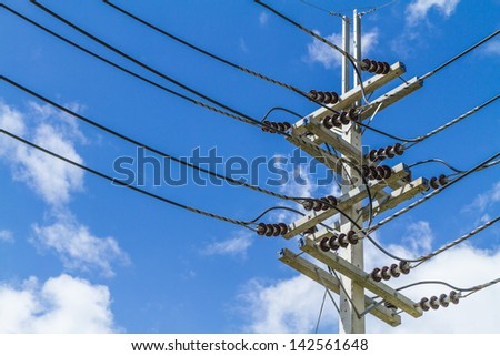 electrical pole with power line cables - stock photo