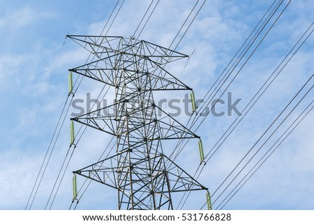 Electrical poles of high voltage in white cloud and blue sky.