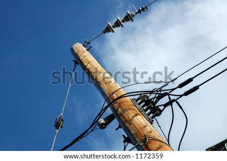 Electrical post outdoors with blue sky at the background