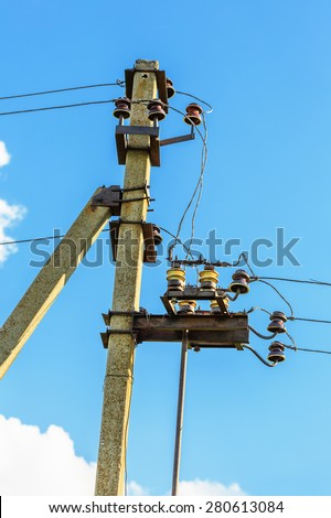 Electrical post with power line cables against blue sky - stock photo