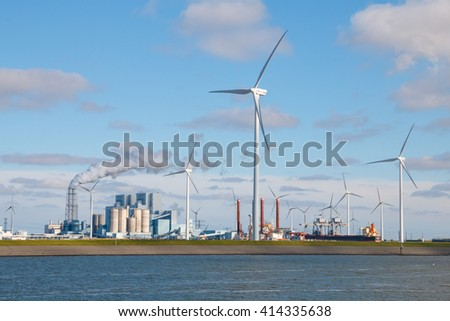Electrical power generation from fossil fuel coal plant and wind energy at the Eemshaven Seaport in Groningen, Netherlands - stock photo