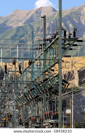 Electrical Power Grid under Mountains - stock photo
