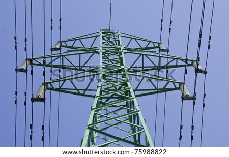 Electrical power line on blue sky background - stock photo