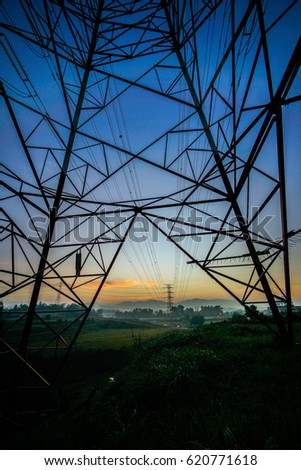 Electrical power lines and pylons at dusk