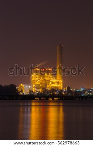 electrical power plant near the sea coat at night, Rayong, Thailand