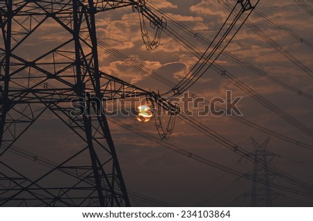 Electrical pylon and high voltage power lines near transformation station at Sunrise in Gurgaon - stock photo