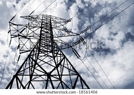 Electrical pylon and power lines with a cloudy sky.