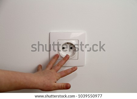 electrical security for safety home of ac power outlet for babies, baby hands playing with electric plug