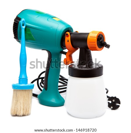electrical spray gun for coloration, for color pulverization and a paintbrush  - stock photo