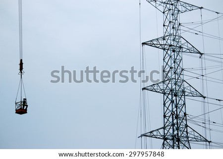 Electrical Steel tower & crane - stock photo
