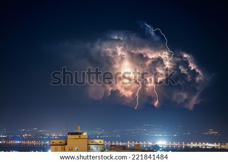 Electrical storm over the city by night - stock photo