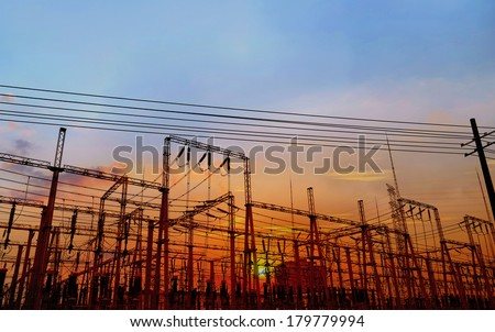 Electrical substation on the sunset background - stock photo