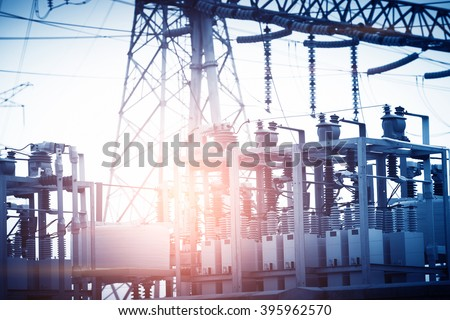 Electrical substation silhouette on the dramatic sunset background - stock photo