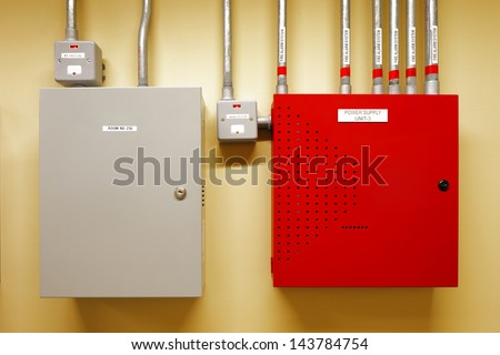 Electrical switch gear and circuit breakers are usually securely locked in the control rooms of new commercial buildings - stock photo