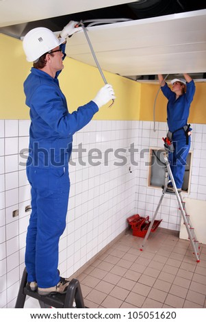 Electrical team wiring a room - stock photo