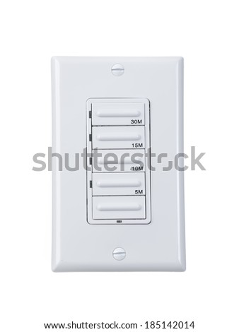 Electrical timer switch isolated on wall - stock photo