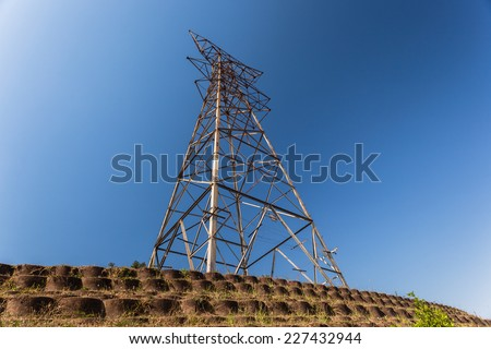 Electrical Tower Stripped  Electrical  tower metal structure stripped of power cables bare in blue sky