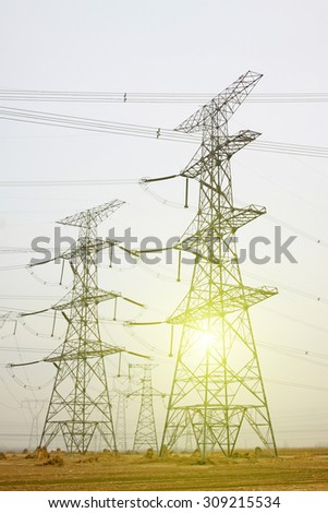Electrical towers and power lines, closeup of photo  - stock photo