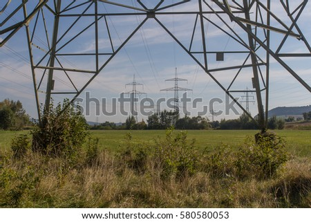 electrical towers in between spring landscape next to Schwandorf in Bavaria