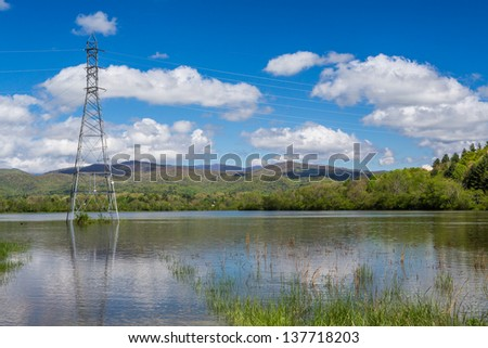 Electrical towers stand in flooded waters of Transylvania County, NC in 2013