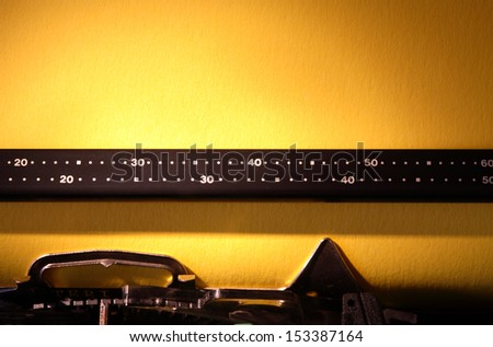 Electrical typewriter closeup with blank yellow paper sheet for your text