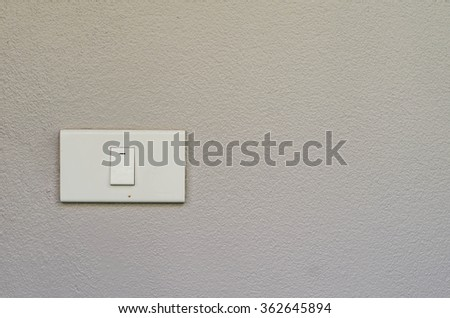 Electrical white rocker light switch on wall. - stock photo