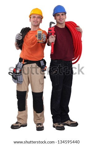 Electrician and plumber displaying equipment - stock photo