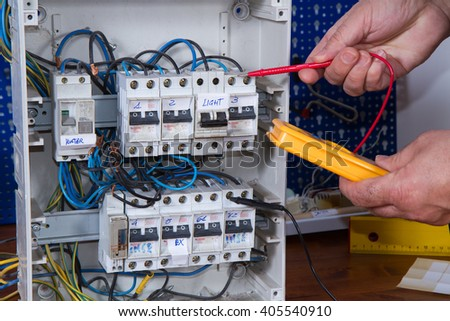 electrician at work with an appliance - stock photo