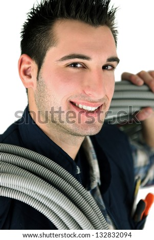 Electrician carrying long wires - stock photo