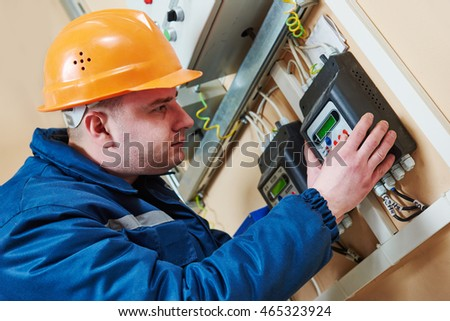 electrician connecting electricity counter meter in fuse box